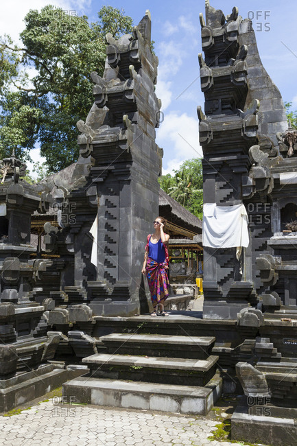 Caucasian tourist girl in a balinese temple, Ubud Bali