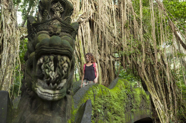 Caucasian tourist girl in the monkey forest of Ubud Bali