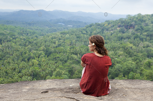 Caucasian tourist girl at high viewpoint with a palm trees, Sri Lanka