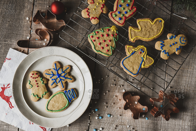 Christmas shaped cookies on plate and cooling rack shot from above