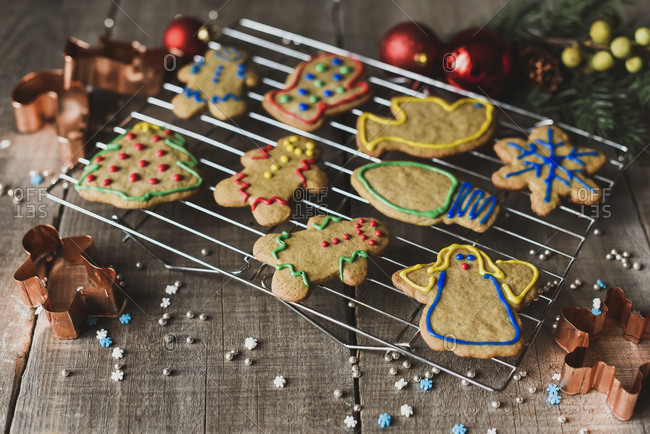 Close up of Christmas shaped gingerbread cookies on cooling rack.