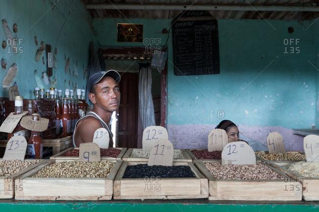Camaguey, Cuba - September 27, 2019: Local vendor of beans in a street market, Camaguey