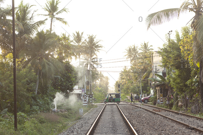 Ahanghama, Sri Lanka - September 27, 2019: Tuk tuk crossing the rail tracks in Sri Lanka