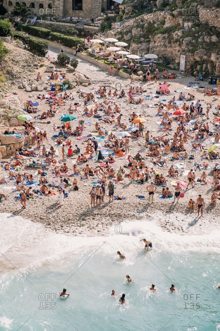 Polignano a Mare, Italy - September 27, 2019: Crowded Beach from Above
