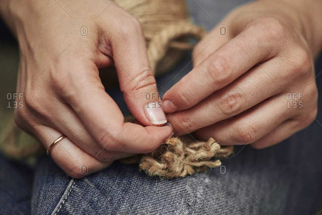 Dressing, manual labor making and cutting the rope