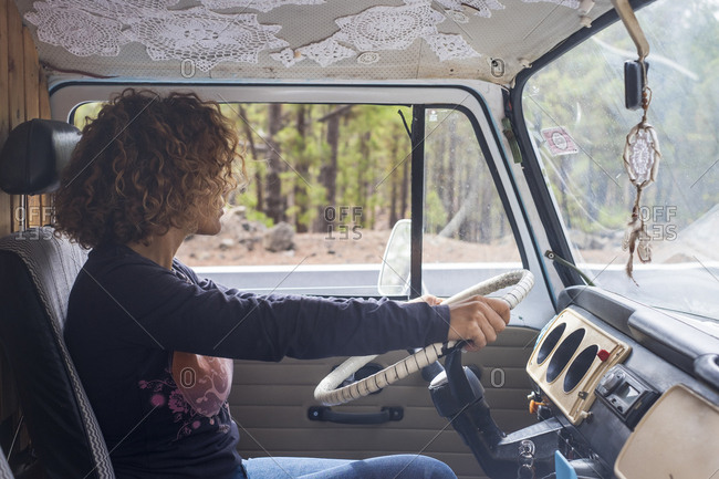 Side view of woman driving travel trailer