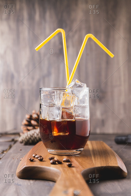 2 plastic straws in an iced coffee still life