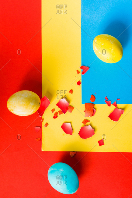 Colored egg over rainbow paper background