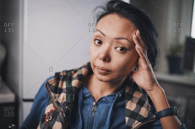 Peaceful woman at home looking at camera