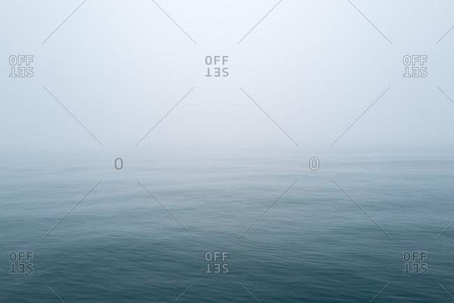 Hazy fog over ocean waters