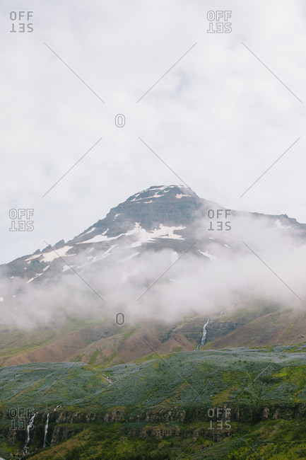 Hazy clouds over mountains in rural Iceland