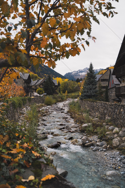 Stone houses in a little village by the river in Pyrenees during autumn