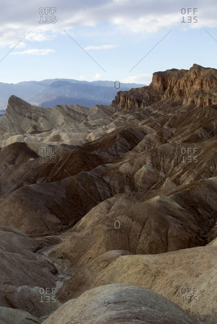 Layered and textured rocky landscape, Zabriskie Point, Death Valley.