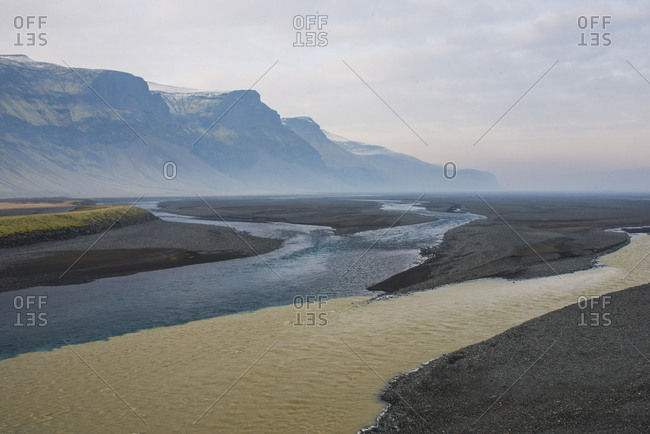 Scenic view of rivers by mountains against sky