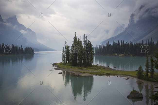 Scenic view of lake by mountains against cloudy sky at Banff National Park