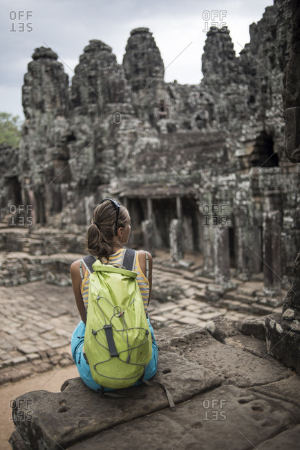 A female tourist at the Bayon, Ankor Thom temple, Angkor Wat, Siem Reap, Cambodia.