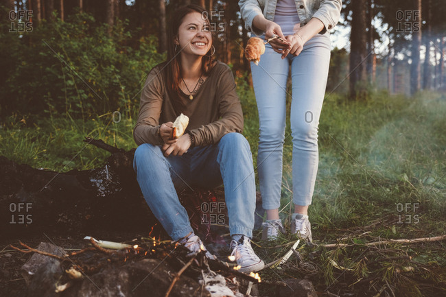 Lesbian couple camping in forest