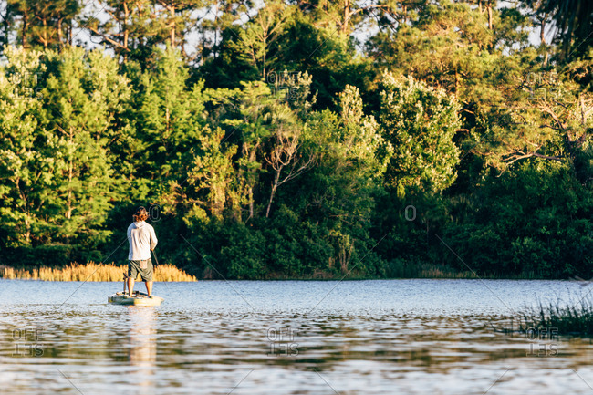 Man Fishing off his Standup Paddleboard