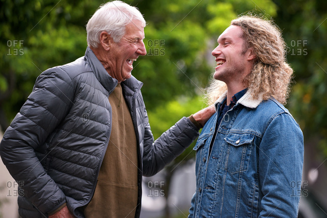 Father and son laughing happy outdoors dad feeling proud showing affection
