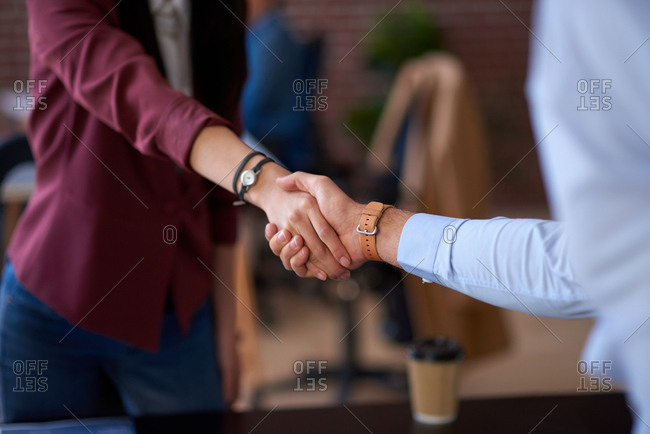 Business people shaking hands in office meeting after successful partnership deal for startup company