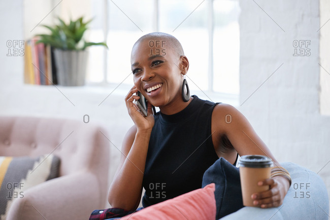 Beautiful african american woman using smartphone having phone call smiling enjoying conversation
