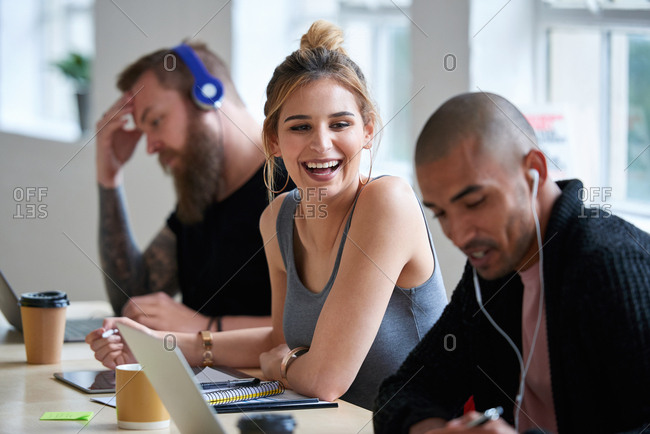 College students in class young woman discussing group project with friend brainstorming ideas together enjoying teamwork