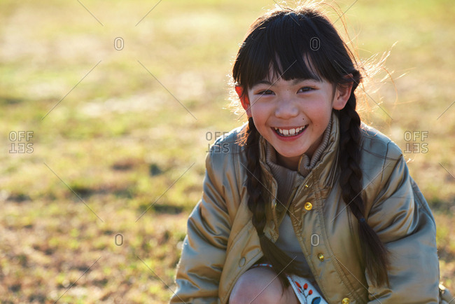 Portrait little asian girl playing in park smiling happy childhood