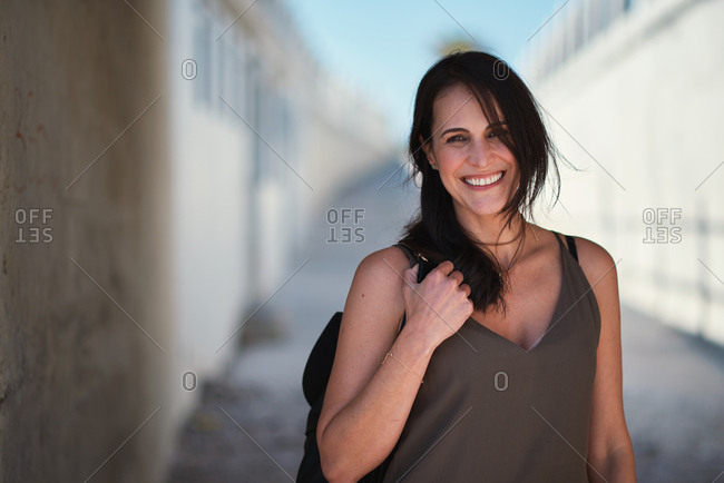 Happy travel woman smiling in city looking confident female tourist enjoying vacation testimonial