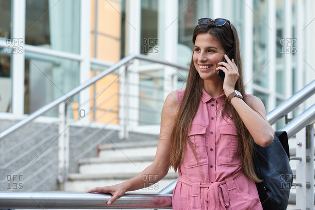 Travel woman using smartphone having phone call talking on mobile phone in city