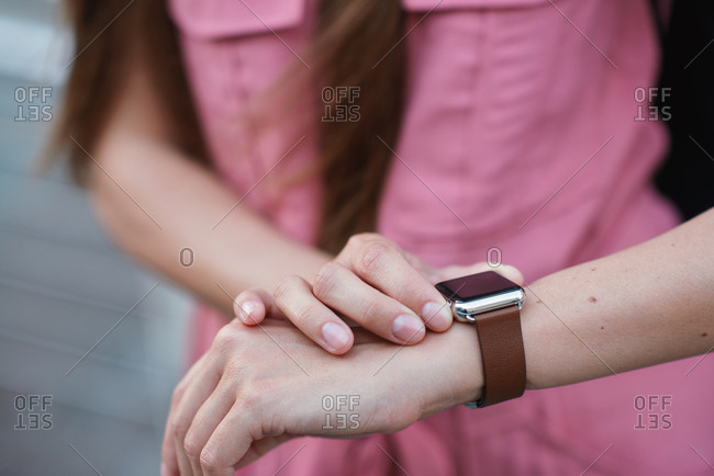 Woman hands using smart watch checking messages wearable mobile technology