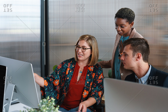Business people using computer african american team leader woman working with colleagues in office brainstorming ideas