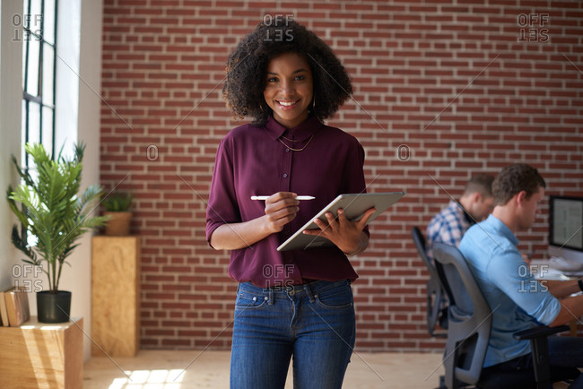 Successful african american business woman smiling using digital tablet computer female manager in office