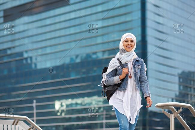 Portrait beautiful muslim woman smiling confident wearing hajib headscarf in city
