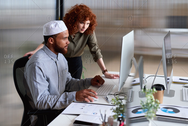 Business people working using computer in office manager woman helping colleague