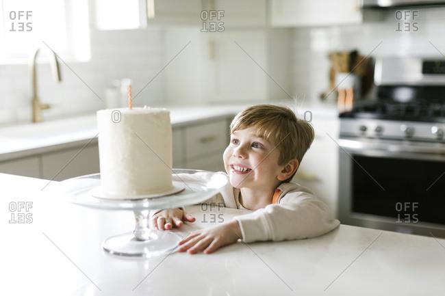 Boy smiling at birthday cake