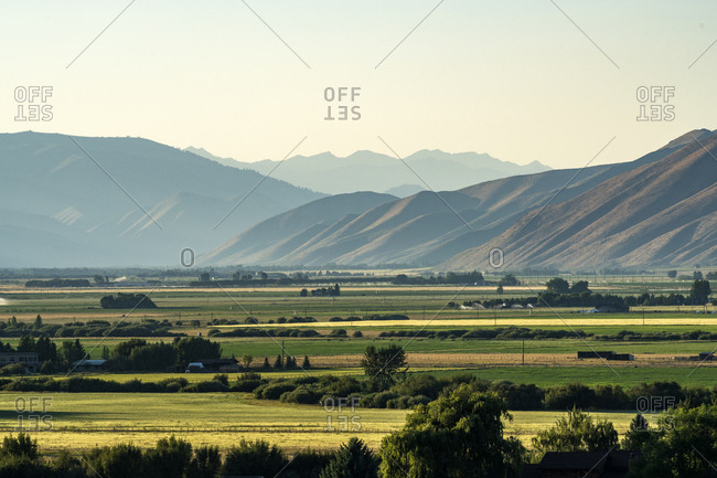 Rural landscape by mountains in Picabo, Idaho, USA