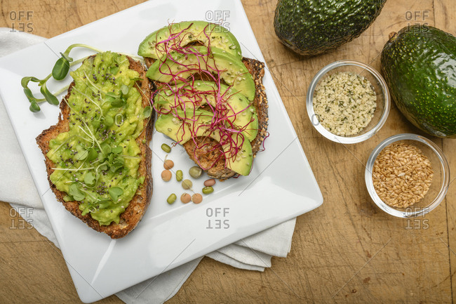 Avocado and bean sprouts on toast