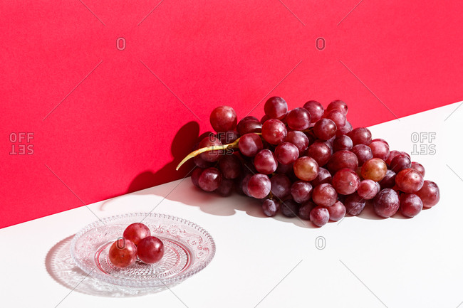 Cluster of red grapes on a white table