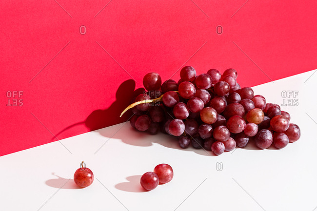 Bunch of red grapes on a white table