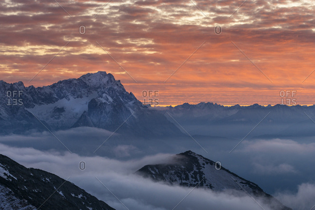 Germany, bavaria, bavarian alps, garmisch-partenkirchen, zugspitze in the nebulous sea at sundown