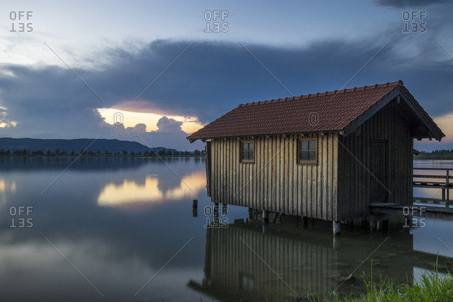 Germany, bavaria, bavarian alps, kochel, boathouse at the kochelsee at sundown
