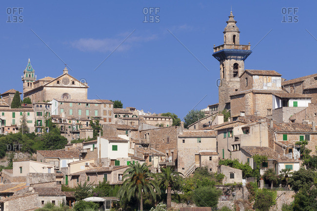 Valldemossa (valldemosa) with chartreuse sa cartoixa and parish church sant bartomeu, majorca, the balearic islands, spain