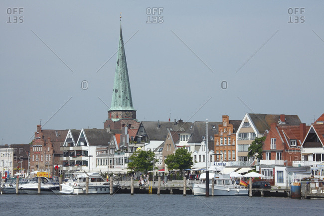 June 12, 2013: houses in the front row, promenade, st. lorenz-kirche (church), lubeck-travemunde, schleswigholstein, germany,