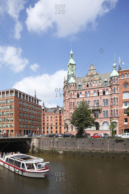August 5, 2015: so-called hafenrathaus (building) with launch, speicherstadt / warehouse district, hafencity, hamburg, germany