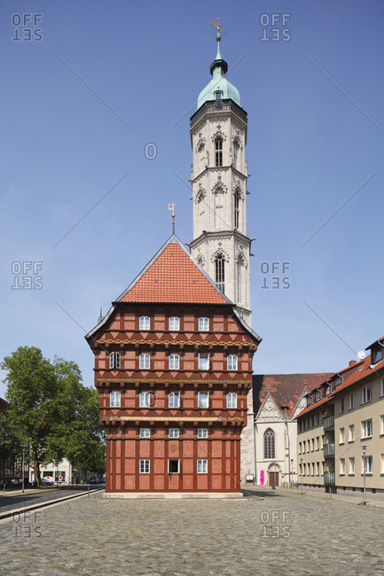 August 10, 2015: germany, lower saxony, brunswick, alte waage (house) with andreaskirche (church)