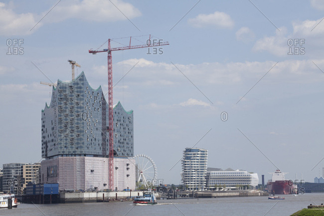 April 29, 2014: elbphilharmonie / elbe philharmonic hall with elbe river, hamburg, germany, europe