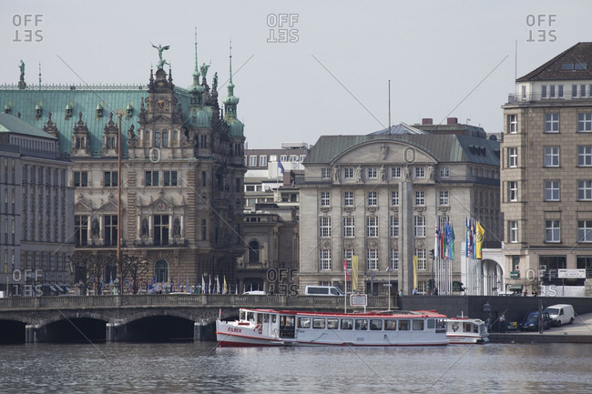 April 29, 2014: the inner alster with alsterschiff (ship) and wing of the city hall of hamburg, hamburg, germany, europe