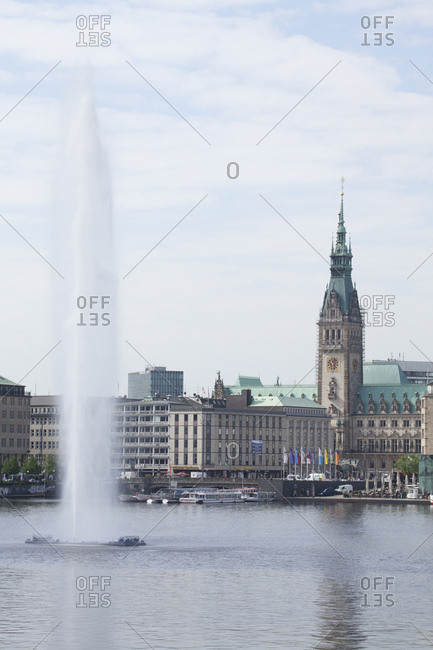 April 29, 2014: the inner alster with water fountain and the city hall of hamburg, hamburg, germany, europe