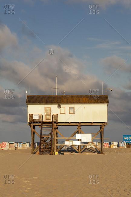 August 22, 2012: stilt houses on the beach of saint peter ording, peninsula eiderstedt, schleswig holstein, germany