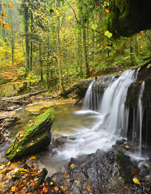 Germany, baden-wurttemberg, swabian-franconian forest, close backnang, strumpfelbachtal, waterfall in the course of the strumpflebach (brook), colorful autumn foliage